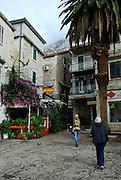 Mature women walking through back-streets of Makarska, Croatia