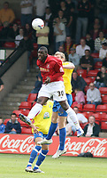 Photo: Mark Stephenson.<br />Walsall v Hereford United. Coca Cola League 2. 09/04/2007. Walsall's Trevor Benjamin win's the header from Hereford's Dean Beckwith