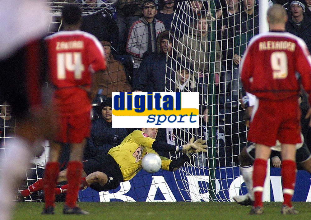 Photo: Paul Thomas.<br />Fulham v Leyton Orient. The FA Cup. 08/01/2006.<br /><br />Orient keeper Glyn Garner saves the penalty shot by Fulhams Collins John. Orient players Gabriel Zakuani and Gary Alexander watch.