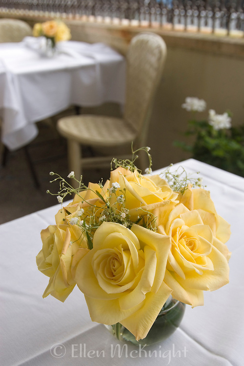 Yellow roses at a wedding table