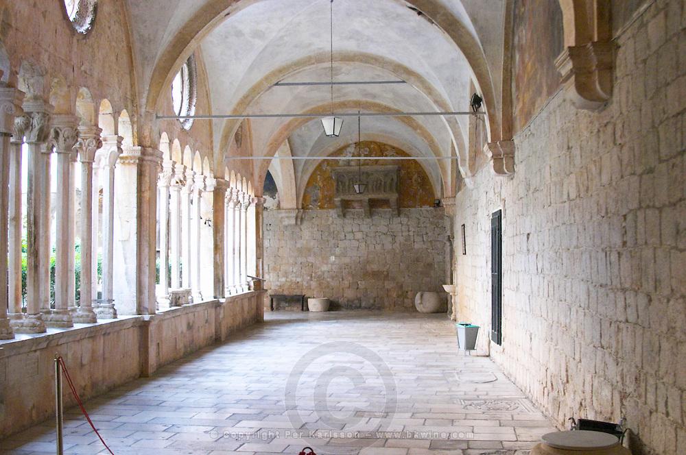 Interior arched courtyard of the Sainte Claire Sveti Klare convent Dubrovnik, old city. Dalmatian Coast, Croatia, Europe.