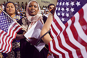 """04 JULY 2009 -- PHOENIX, AZ: JAWAHER ABBAS, originally from the Sudan, becomes a US citizen at a naturalization ceremony in Phoenix, AZ, July 4. U.S. Citizenship and Immigration Services and South Mountain Community College in Phoenix, AZ, hosted the 21st annual """"Fiesta of Independence"""" Saturday, July 4. More than 180 people from 58 countries took the US Oath of Citizenship and became naturalized US citizens. The ceremony was one of dozens of similar ceremonies held across the US this week. USCIS said more than 6,000 people were naturalized US citizens during the week.  Photo by Jack Kurtz / ZUMA Press"""
