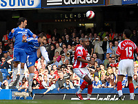 Photo: Ed Godden.<br />Chelsea v Charlton Athletic. The Barclays Premiership. 09/09/2006. Ricardo Carvalho (far left) climbs above team mate John Terry, to score the winner for Chelsea.