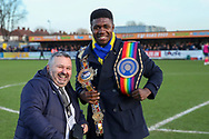 Boxer Lerrone Richards on Kingsmeadow/ Cherry Red Records Stadium pitch with Ivor Heller during the EFL Sky Bet League 1 match between AFC Wimbledon and Peterborough United at the Cherry Red Records Stadium, Kingston, England on 18 January 2020.