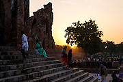 """5th February 2015, New Delhi, India. Worshippers ascend and descend steps in Feroz Shah Kotla in New Delhi, India on the 5th February 2015 <br /> <br /> PHOTOGRAPH BY AND COPYRIGHT OF SIMON DE TREY-WHITE a photographer in delhi. + 91 98103 99809. Email:simon@simondetreywhite.com<br /> <br /> People have been coming to Firoz Shah Kotla to leave written notes and offerings for Djinns in the hopes of getting wishes granted since the late 1970's. Jinn, jann or djinn are supernatural creatures in Islamic mythology as well as pre-Islamic Arabian mythology. They are mentioned frequently in the Quran  and other Islamic texts and inhabit an unseen world called Djinnestan. In Islamic theology jinn are said to be creatures with free will, made from smokeless fire by Allah as humans were made of clay, among other things. According to the Quran, jinn have free will, and Iblīs abused this freedom in front of Allah by refusing to bow to Adam when Allah ordered angels and jinn to do so. For disobeying Allah, Iblīs was expelled from Paradise and called """"Shayṭān"""" (Satan).They are usually invisible to humans, but humans do appear clearly to jinn, as they can possess them. Like humans, jinn will also be judged on the Day of Judgment and will be sent to Paradise or Hell according to their deeds. Feroz Shah Tughlaq (r. 1351–88), the Sultan of Delhi, established the fortified city of Ferozabad in 1354, as the new capital of the Delhi Sultanate, and included in it the site of the present Feroz Shah Kotla. Kotla literally means fortress or citadel."""