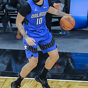 ORLANDO, FL - FEBRUARY 19:  Evan Fournier #10 of the Orlando Magic controls the ball against Golden State Warriors during the first half at Amway Center on February 19, 2021 in Orlando, Florida. NOTE TO USER: User expressly acknowledges and agrees that, by downloading and or using this photograph, User is consenting to the terms and conditions of the Getty Images License Agreement. (Photo by Alex Menendez/Getty Images)*** Local Caption *** Evan Fournier