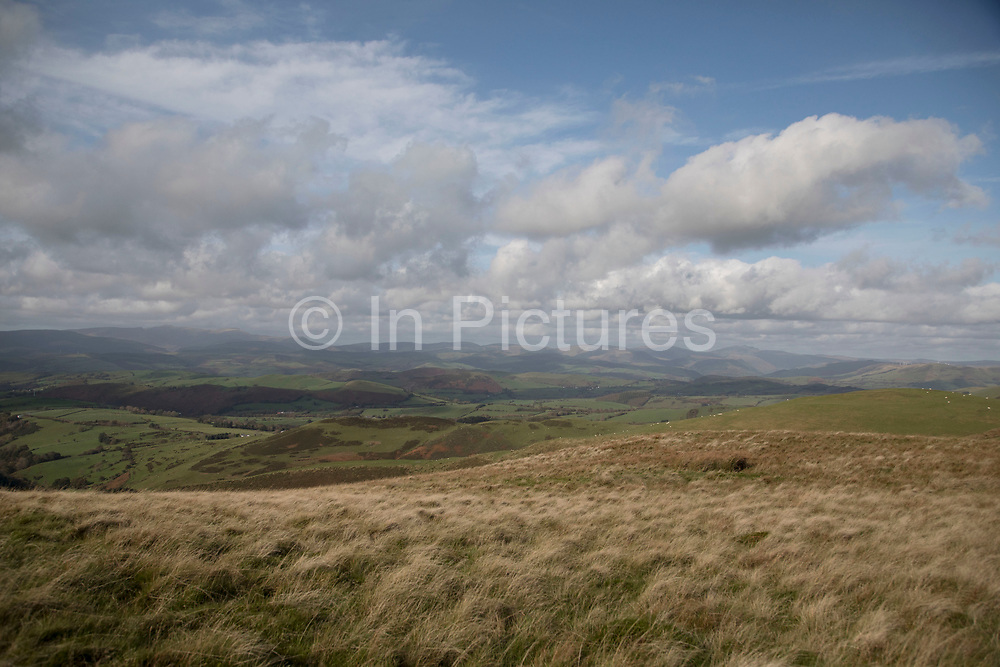 View towards Cader Idris in Wales, United Kingdom. Cadair Idris or Cader Idris is a mountain in Gwynedd, Wales, which lies at the southern end of the Snowdonia National Park.