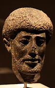 Head of a statue of a bearded man. Granite; Greek 3rd century BC