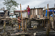 2016/10/06 - Muisne, Ecuador: Two brothers reconstruct the house of their family on the island of Muisne, Ecuador, 6th October 2016.  Even living in precarious conditions the inhabitants of Muisne, refuse to leave the island, even when it's recommended by the Government, since it is considered a high-risk area. The population in the island claim that they were born there and they don't know any other way of living, so they refuse the abandon the place that they call home for generations. (Eduardo Leal)
