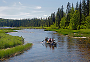 Alaska, Canoeing Byers Creek at the outfall from Byers Lake, Denali State Park.