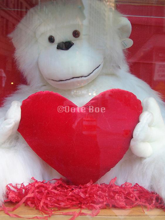 A teddy bear holding a heart.