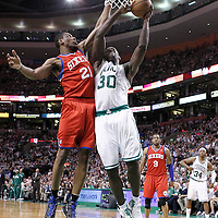 21 May 2012: Boston Celtics power forward Brandon Bass (30) is fouled by Philadelphia Sixers forward Thaddeus Young (21) during the Boston Celtics 101-85 victory over the Philadelphia Sixer, in Game 5 of the Eastern Conference semifinals playoff series, at the TD Banknorth Garden, Boston, Massachusetts, USA.