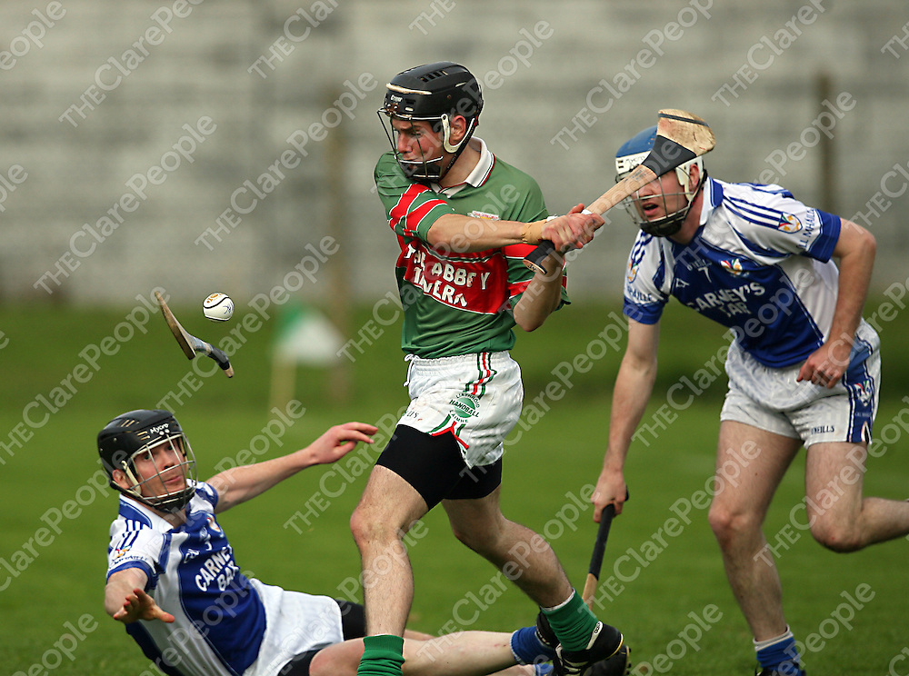 Kilmaley's Anthony Cahill and John Clohessy try any means to stop the advances of Clooney/Quins Derek Ryan during their game in Shannon on Saturday evening.<br /> Photograph by Yvonne Vaughan
