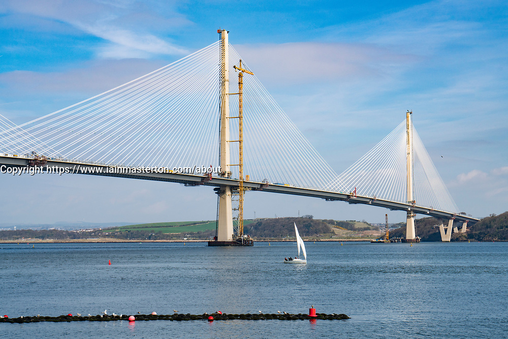 View of new Queensferry Crossing bridge under construction spanning River Forth from South Queensferry in Scotland, United Kingdom.