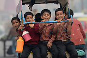 School children hold on as they make their way to classes in Agra, India on Monday, November 5, 2012. THE CANADIAN PRESS/Sean Kilpatrick