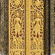 Golden door at Wat Xieng Thong (Temple of the Golden City) on the northern tip of the peninsula of Luang Prabang, Laos. Originally built around 1560, the temple was the main site for royal coronations and remains ones of the most important temples in Laos.