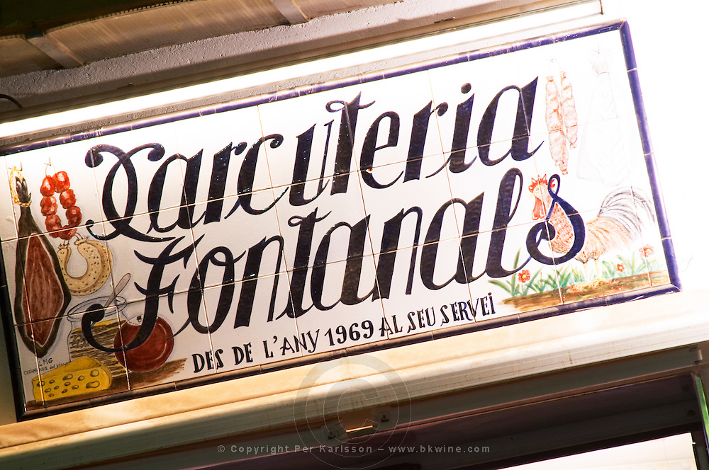 Shop sign: charcuteri and butcher. Sitges, Catalonia, Spain