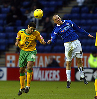 Photo: Chris Ratcliffe.<br />Leicester City v Norwich City. Coca Cola Championship. 31/12/2005.<br />Youssef Safri (L) of Norwich beats Iain Hume of Leicester to the ball.