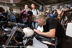 Custom bike painting demo by Mario Leuci<br /> at EICMA, the largest international motorcycle exhibition in the world. Milan, Italy. November 18, 2015.  Photography ©2015 Michael Lichter.