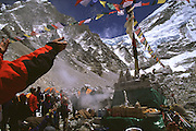 Throwing rice during Puja at Everest Base Camp