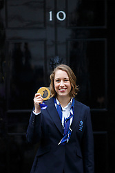© licensed to London News Pictures. London, UK 25/02/2014. Women's Skeleton gold medalist, Lizzy Yarnold poses with her medal as Winter Olympic medal winners of Team GB visiting Downing Street to meet Prime minister David Cameron on Tuesday, 25 February 2014 after their success in the Sochi 2014 Winter Olympics. Photo credit: Tolga Akmen/LNP