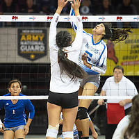 Laguna's Jacqueline Day (5) goes up for a spike in their match against Santa Fe Indian Thursday morning at the Santa Ana Star Center in the NMAA Class 3A State Volleyball tournament in Rio Rancho.