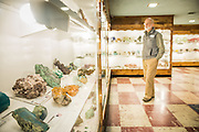 Julian Grey, Director of the Rice Museum, tours the Rudy Tschernich Northwest Mineral Gallery in the basement of the Rice Museum of  Rocks and Minerals. The museum features a large number of thundereggs, sunstones, gems, outstanding crystals, lapidary speciments and petrified wood.