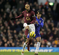 Photo: Lee Earle.<br /> Arsenal v Chelsea. The Barclays Premiership. 18/12/2005. Arsenal's Thierry Henry (F) holds off Paulo Ferreira.