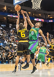 July 6, 2018 - Oakland, CA, U.S. - OAKLAND, CA - JULY 06: Qyntel Woods (6) of 3 Headed Monsters blocks a shot by Alan Anderson (6) of the Killer 3s during game 4 in week three of the BIG3 3-on-3 basketball league on Friday, July 6, 2018 at the Oracle Arena in Oakland, CA  (Photo by Douglas Stringer/Icon Sportswire) (Credit Image: © Douglas Stringer/Icon SMI via ZUMA Press)