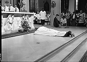 Episcopal Ordination Of Desmond Connell. (R74).1988..06.03.1988..03.06.1988..6th March 1988..Following the death of Archbishop Kevin McNamara in April '87, Pope John Paul II surprisingly nominated Desmond Connell for the position of Archbishop of Dublin. The ordination of Dr Connell took place at the Pro-Cathedral in Dublin...Image shows Archbishop elect of Dublin, Desmond Connell,lying prostrate before the alter in the Pro-Cathedral.