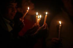 April 14, 2017 - Gaza, Gaza strip, Palestine - Palestinian boys hold candles during a protest against the blockade on Gaza, in Gaza City April 14, 2017. (Credit Image: © Majdi Fathi/NurPhoto via ZUMA Press)