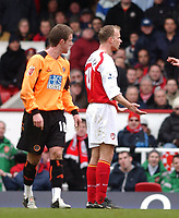 Photo. Daniel Hambury, Digitalsport<br /> Arsenal v Sheffield United. <br /> FA Cup Fifth Round.<br /> 19/2/2005.<br /> Arsenal's Dennis Bergkamp looks stunned as he is sent off.