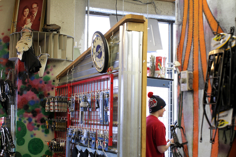 Mechanic Ty Spangle, 17, fixes bicycles in the workshop portion of Express Bike Shop in St. Paul, Minnesota. Half the store is for mechanical work and the other half is retail.