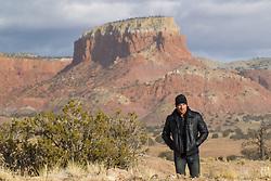 hot man walking in the Southwest