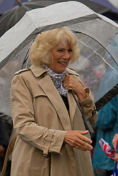© Licensed to London News Pictures. 02/07/2012. Camborne, UK. The Duchess of Cornwall greets members of the public on arrival at the.Heartlands Project. The Duke and Duchess of Cornwall are on a three day tour of Cornwall and the Isles of Scilly. Photo credit : Ashley Hugo/LNP