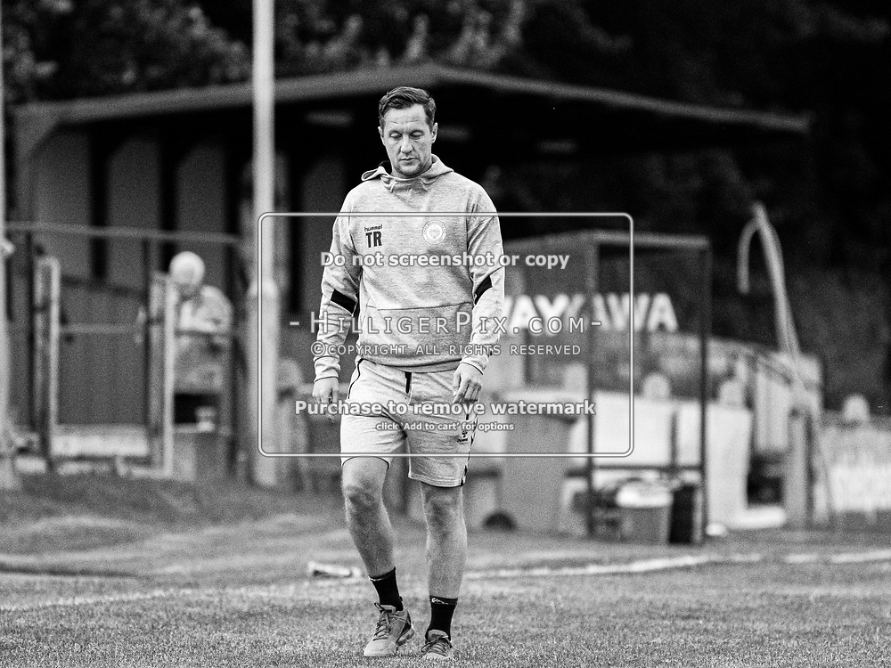 DARTFORD, UK - AUGUST 01: Tony Russell, Manager of Cray Wanderers FC, walks off the pitch at half time during the pre-season friendly match between Phoenix Sports FC and Cray Wanderers FC at The Mayplace Ground on August 1, 2019 in Dartford, UK. <br /> (Photo: Jon Hilliger)