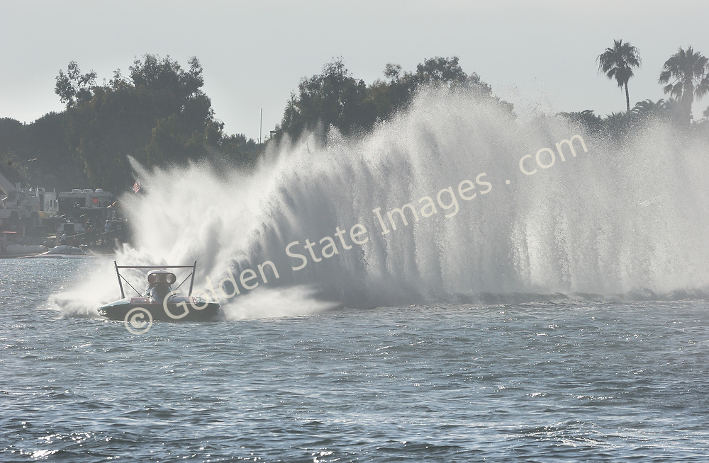 Oh Boy Oberto throws a roostertail in turn four.
