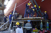 JEANIE JOHNSTON 18-4-00.Workmen work frantically to get the Jeanie Johnston ready for transfer to the floating barge at Blennerville, Tralee yesterday.  The boat will be taken today (Wednesday) to Fenit where it will be put into the sea..Picture by Don MacMonagle