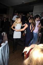 SIENNA MILLER and Giannina Facio at a party to celebrate the launch of Hollywood Domino - a brand new board game, held at Mosimann's 11b West Halkin Street, London on 7th November 2008.  The evening was in aid of Charlize Theron's Africa Outreach Project.