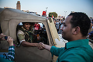 The Egyptian military arrives to a crowd of jubliant demonstrators who heard news of Morsi's arrest.