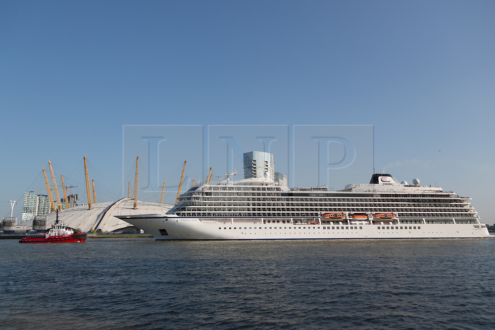 © Licensed to London News Pictures. 06/05/2018. London, UK. 228-metre-long cruise ship Viking Sun seen making her past the O2 on her way down the River Thames at the end of a 3 day visit to Greenwich in south east London. The visit by Viking Sun, which has a capacity of 930 passengers, marks the beginning of London's cruise ship season. For passengers on board, London was the end of a 141 night round the world cruise which started in Miami last December. Photo credit : Rob Powell/LNP