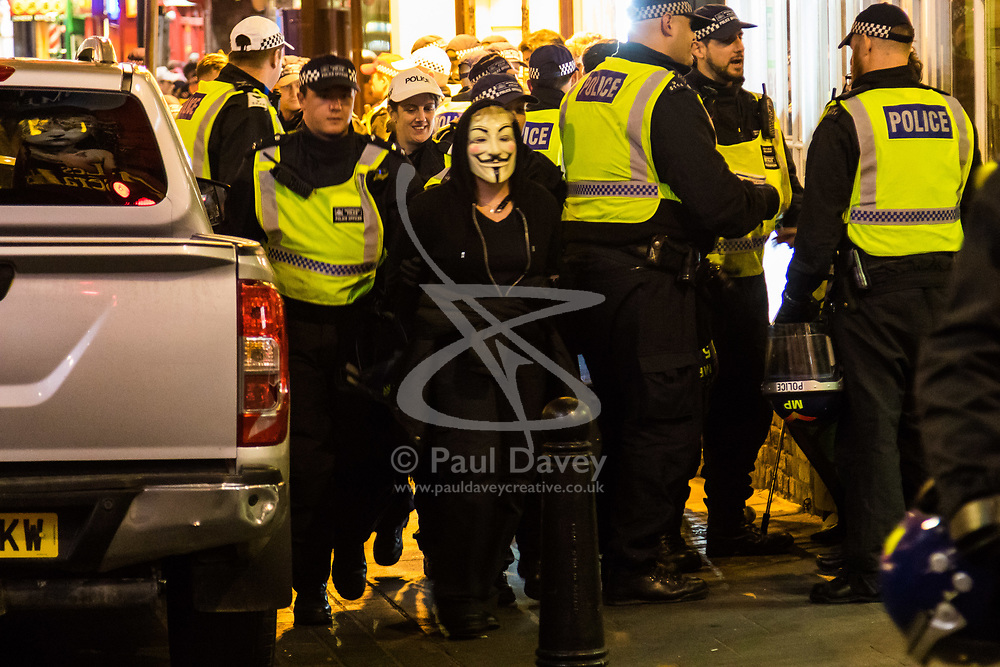 London, November 05 2017. Anti-capitalists gather in Trafalgar Square, London for the annual 'Million Mask March' which happens on November 5th every year, with many of the protesters donning 'V' For Vendetta Guy Fawkes masks. Past marches have turned violent with police horses shot by fireworks and police vehicles burned. PICTURED: A protester is arrested in Chinatown. © Paul Davey