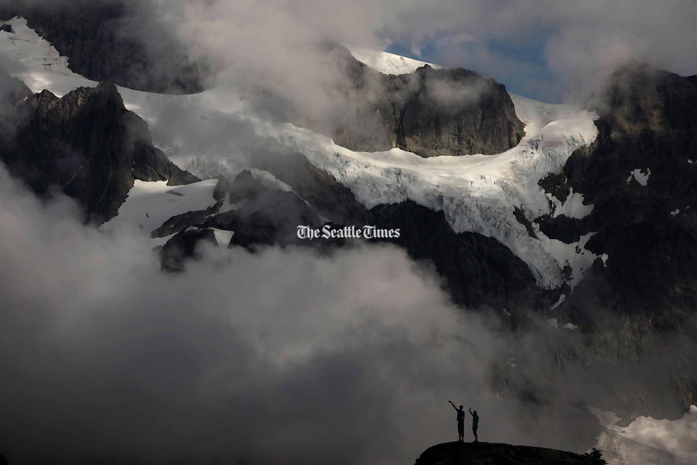 Visitors at Artist Point at the end of the Mount Baker Highway.  The area offers 360-degree views of Mount Baker and Mount Shuksan. (Erika Schultz / The Seattle Times)