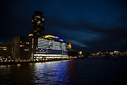 Night view across the River Thames towards the Oxo Tower and Sea Containers House on the Southbank, London, United Kingdom. The South Bank is a significant arts and entertainment district, and home to an endless list of activities for Londoners, visitors and tourists alike.