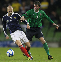 Football - Carling Nations Cup - Scotland v Northern Ireland<br /> Alan Hutton and Pat McCourt in action during the Scotland v Northern Ireland Carling Nations Cup at The Aviva Stadium