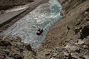A truck seen in the water after falling down a cliff, 23rd October 2009, Himachal Pradesh, India. The trucks drive along roads in this area that are often precarious, with vehciles seen clinging to the edge with a sheer cliff drop on the side. The region of Spiti and Kinnaur is a remote and tribal area of the Indian Himalayas near the Tibetan border.