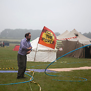 A plumber tames the water pipes. Reclaim the Power camp is set up in a field near Balcombe. The site is squatted but so far nor the owner nor police has made any moves to stop the camp from setting up. It is organised by the environmental group No Dash for Gas and the movement is protesting against the company Cuadrilla's fracking testing near Balcombe and have come to Balcombe to lend its support to the local protests against the drilling for gas.