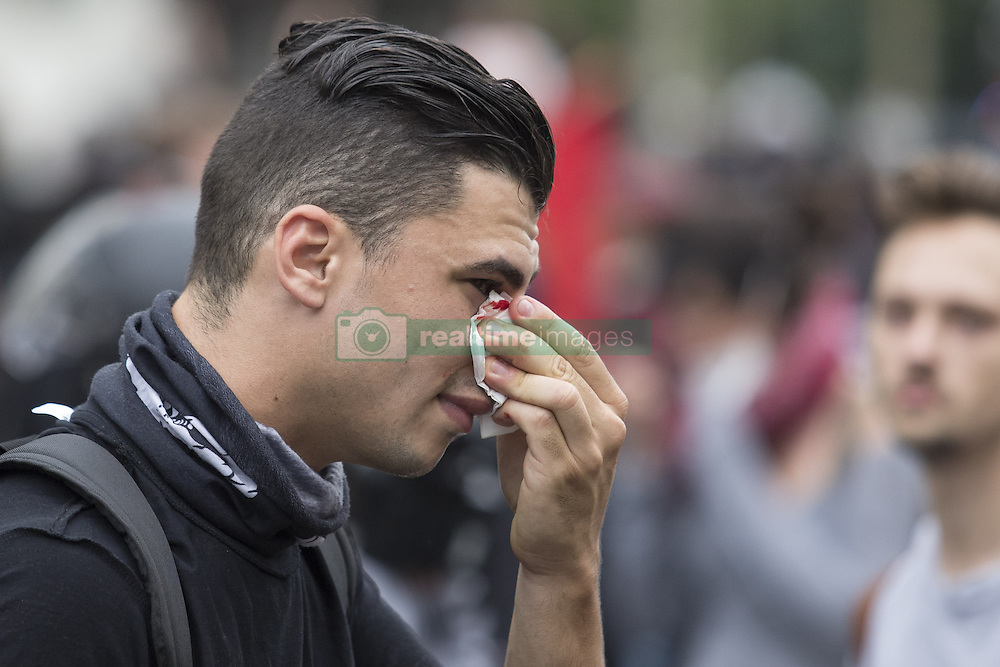 September 15, 2016 - Paris, France - A man bleeds after being injured following clashes with French riot police during a demonstration against the controversial labour reforms of the French government in Paris on September 15, 2016...Opponents of France's controversial labour reforms took to the streets on September 15, 2016 for the 14th time in six months in a last-ditch bid to quash the measures that lost the Socialist government crucial support on the left. Scores of flights in and out of France were cancelled as air traffic controllers went on strike to try to force the government to repeal the changes that became law in July. GEOFFROY VAN DER HASSELT. (Credit Image: © Geoffroy Van Der Hasselt/NurPhoto via ZUMA Press)