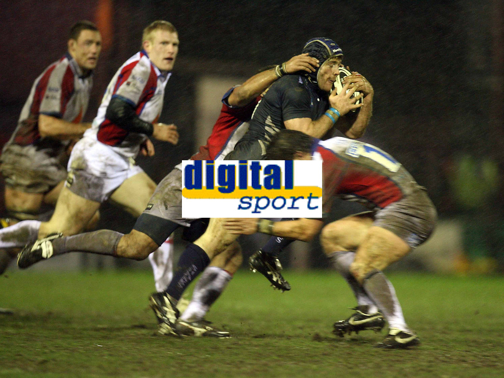 Photo: Rich Eaton.<br /> <br /> Sale Sharks v Bristol Rugby. Guinness Premiership. 01/01/2007. Magnus Lund centre of Sale is stopped by the strong Bristol defence