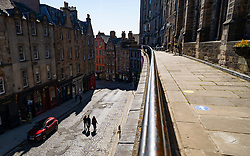 Edinburgh, Scotland, UK. 25 April 2021. Scenes from streets of Edinburgh city centre on Sunday afternoon on the day before non-essential shops and businesses can reopen in Scotland under relaxed covid-19 lockdown rules. Pic. Historic Victoria Street in the Old town is almost deserted. Iain Masterton/Alamy Live News